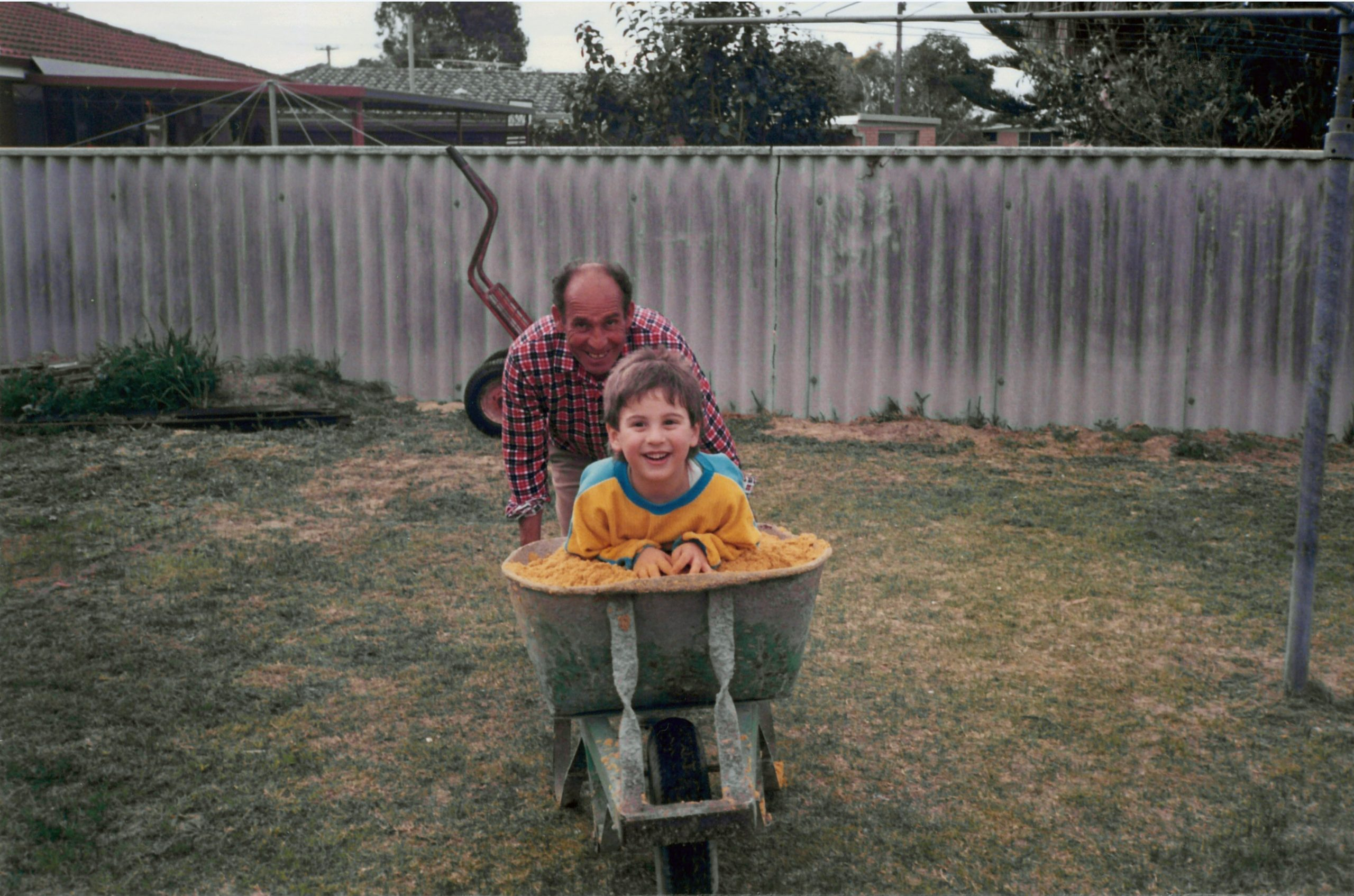 Anthony in wheelbarrow